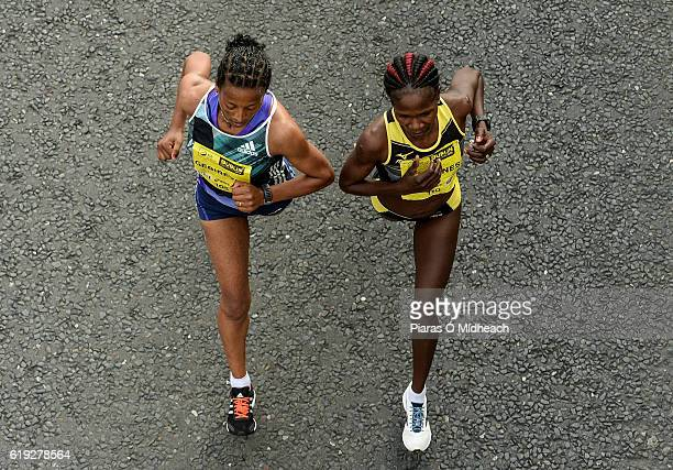 Dublin , Ireland - 30 October 2016; Ehite Bizuayehu Gebireyes from Ethiopia, left, Helalia Johannes from Nambia lead the women's race during the SSE...