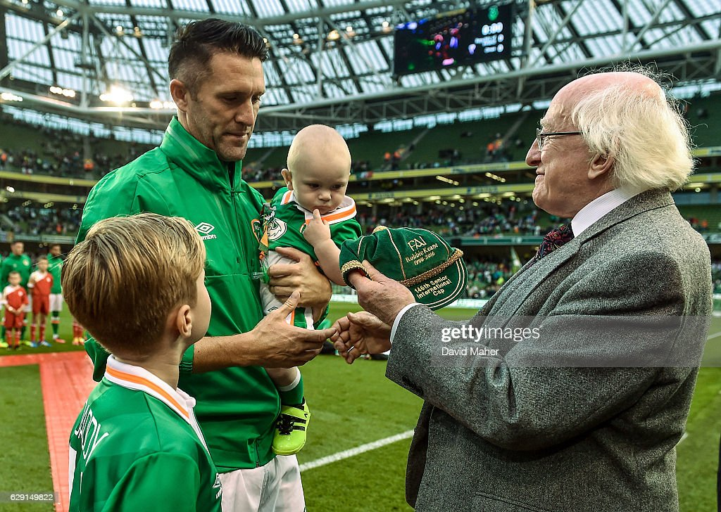 Dublin , Ireland - 31 August 2016; The President of Ireland Michael D. Higgins presents Robbie Keane of Republic of Ireland with his 146th International Cap during the Three International Friendly game between the Republic of Ireland and Oman at the Aviva Stadium in Lansdowne Road, Dublin.