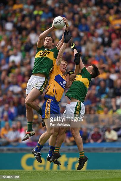 Dublin Ireland 31 July 2016 Shane Enright of Kerry catches the ball under pressure from his team mate Brian Ó Beaglaoich and Pearse Lillis of Clare...