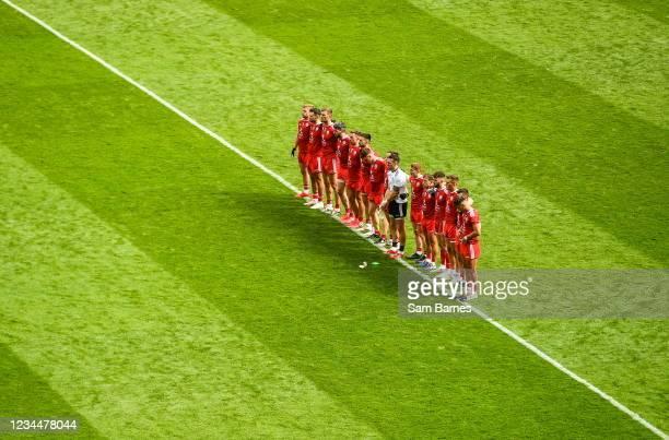 Dublin , Ireland - 31 July 2021; The Tyrone team stand for the national anthem, Amhrán na bhFiann, before the Ulster GAA Football Senior Championship...