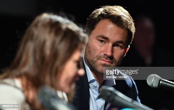 Dublin Ireland 31 October 2017 Promoter Eddie Hearn watches WBA World Lightweight Champion Katie Taylor during a press conference at the Irish Film...