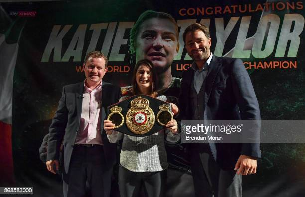 Dublin Ireland 31 October 2017 WBA World Lightweight Champion Katie Taylor with manager Brian Peters left and promoter Eddie Hearn during a press...