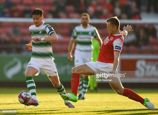 Dublin , Ireland - 4 May 2018; Ronan Finn of Shamrock Rovers in action against Jamie Lennon of St Patrick's Athletic during the SSE Airtricity League...