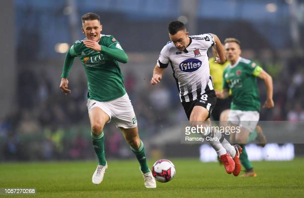Dublin Ireland 4 November 2018 Robbie Benson of Dundalk in action against Barry McNamee of Cork City during the Irish Daily Mail FAI Cup Final match...