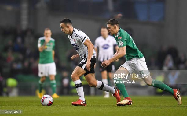 Dublin Ireland 4 November 2018 Robbie Benson of Dundalk in action against Garry Buckley of Cork City during the Irish Daily Mail FAI Cup Final match...