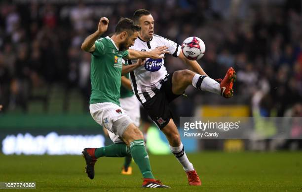 Dublin Ireland 4 November 2018 Robbie Benson of Dundalk in action against Alan Bennett of Cork City during the Irish Daily Mail FAI Cup Final match...