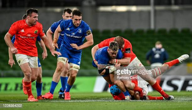 Dublin , Ireland - 4 September 2020; Andrew Porter of Leinster is tackled by Niall Scannell, left, and Stephen Archer of Munster during the Guinness...