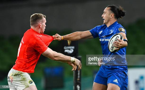 Dublin , Ireland - 4 September 2020; James Lowe of Leinster is tackled by Chris Farrell of Munster during the Guinness PRO14 Semi-Final match between...