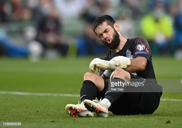 Dublin , Ireland - 4 September 2021; Azerbaijan goalkeeper Shakhrudin Magomedaliyev holds his forearm after an injury during the FIFA World Cup 2022...
