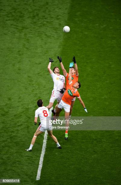 Dublin Ireland 5 August 2017 Colm Cavanagh left and Declan McClure of Tyrone compete for the throwin against against Stephen Sheridan left and Niall...