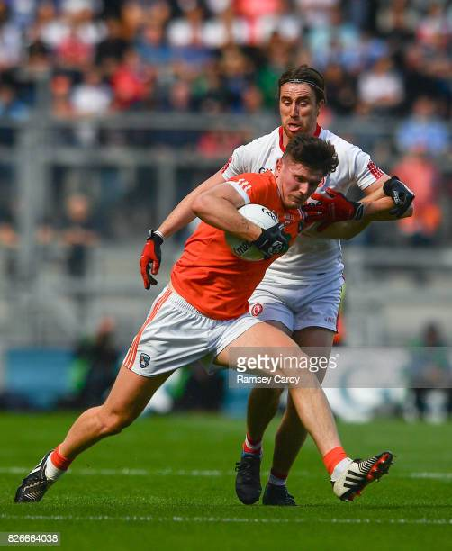 Dublin Ireland 5 August 2017 Joe McElroy of Armagh is tackled by Conall McCann of Tyrone during the GAA Football AllIreland Senior Championship...