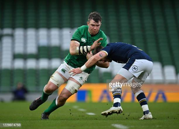 Dublin , Ireland - 5 December 2020; Peter O'Mahony of Ireland in action against Ali Price of Scotland during the Autumn Nations Cup match between...