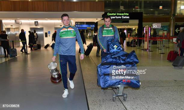 Dublin Ireland 5 November 2017 Ireland vice captain Conor McManus left and teammate Michael Murphy at Dublin Airport with the Cormac McAnallen Cup in...