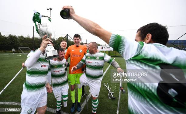 Dublin , Ireland - 5 October 2019; Shamrock Rovers players celebrate with the cup following the National Amputee League Final match between Shamrock...