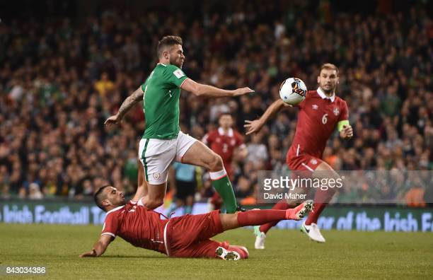 Dublin Ireland 5 September 2017 Daryl Murphy of Republic of Ireland is fouled by Nikola Maksimovi of Serbia resulting in a red card for Maksimovi...