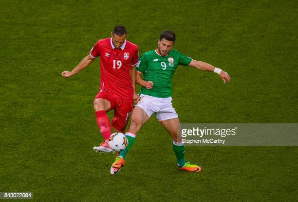 Dublin Ireland 5 September 2017 Nikola Maksimovi of Serbia in action against Shane Long of Republic of Ireland during the FIFA World Cup Qualifier...
