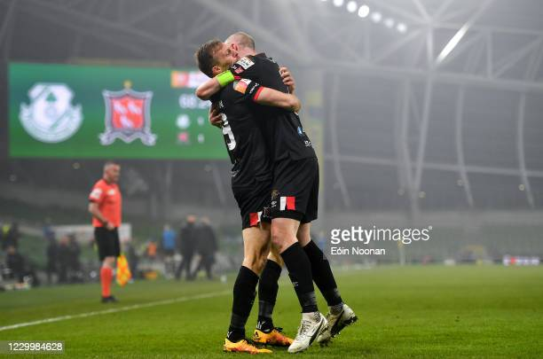 Dublin , Ireland - 6 December 2020; David McMillan of Dundalk celebrates with team-mate Chris Shields after scoring his side's first goal during the...