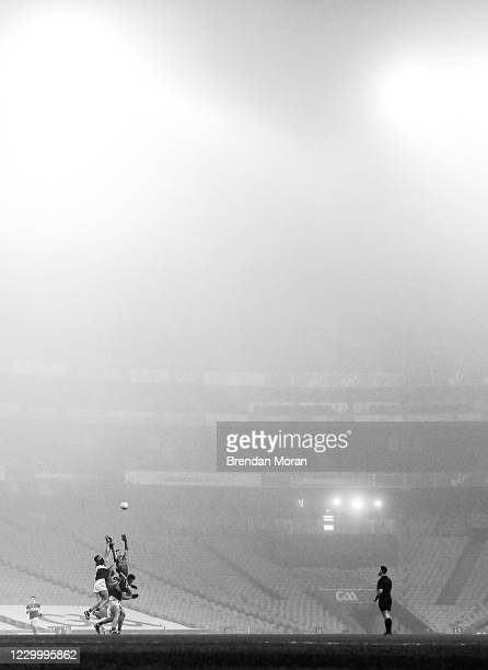 Dublin , Ireland - 6 December 2020; Diarmuid O'Connor of Mayo beats team-mate Aidan O'Shea and Colin O'Riordan of Tipperary to catch the thriw in for...