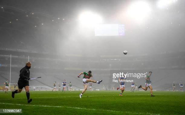 Dublin , Ireland - 6 December 2020; Linesman Brendan Cawley keeps a close eye as Patrick Durcan of Mayo kicks the ball forwards, as fog descends,...