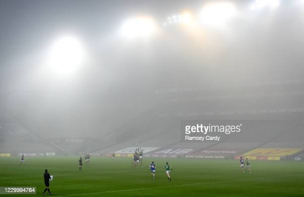 Dublin , Ireland - 6 December 2020; Players contest the throw-in at the start of the second half under heavy fog during the GAA Football All-Ireland...