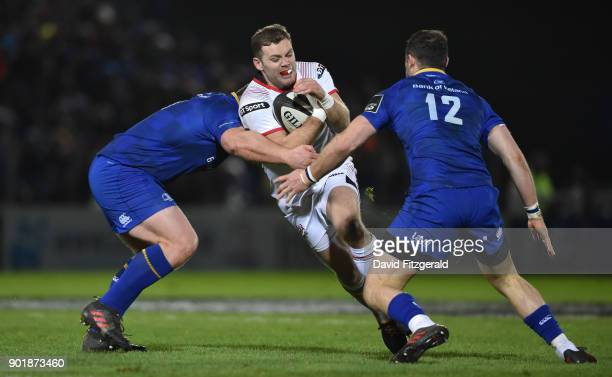 Dublin Ireland 6 January 2018 Darren Cave of Ulster is tackled by Jack McGrath left and Robbie Henshaw of Leinster during the Guinness PRO14 Round 13...