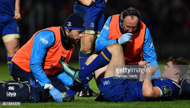 Dublin Ireland 6 January 2018 Garry Ringrose of Leinster is treated for an injury by Leinster senior physiotherapist Karl Denvir left and team doctor...
