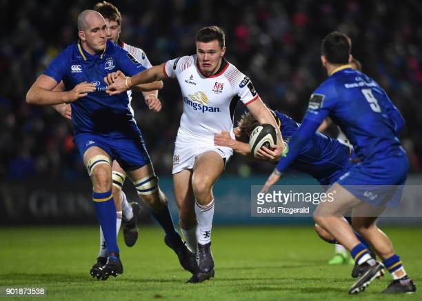 Dublin Ireland 6 January 2018 Jacob Stockdale of Ulster is tackled by Devin Toner left and Jordi Murphy of Leinster during the Guinness PRO14 Round...