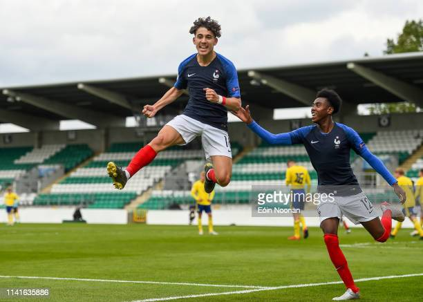 Dublin Ireland 6 May 2019 Adil Aouchiche of France celebrates with teammate Isaac Lihadji after scoring his side's first goal of the game during the...