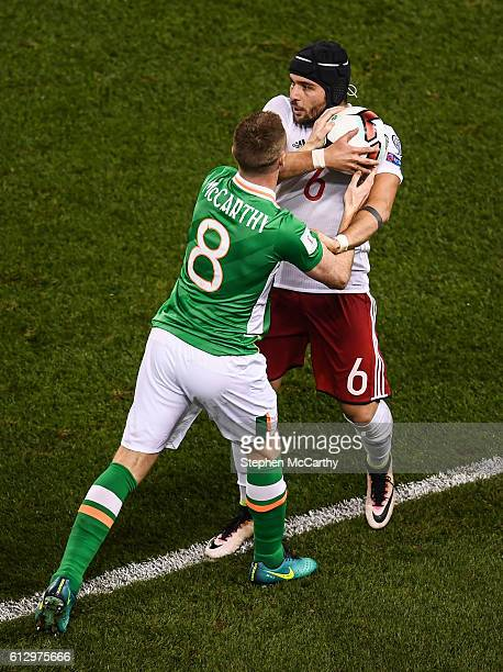 Dublin Ireland 6 October 2016 James McCarthy of Republic of Ireland tussles with Murtaz Daushvili of Georgia during the FIFA World Cup Group D...