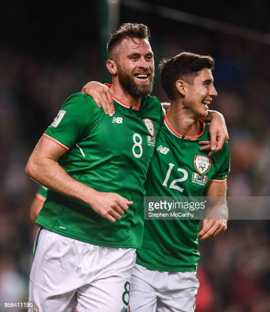 Dublin Ireland 6 October 2017 Daryl Murphy of Republic of Ireland celebrates after scoring his side's second goal with teammate Callum O'Dowda right...