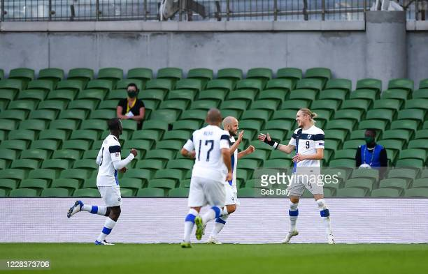 Dublin , Ireland - 6 September 2020; Fredrik Jensen of Finland, right, celebrates with team-mates after scoring his side's first goal during the UEFA...