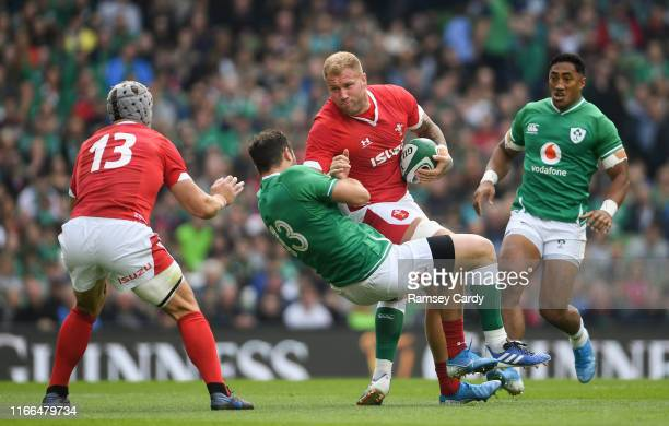 Dublin Ireland 7 September 2019 Ross Moriarty of Wales is tackled by Robbie Henshaw of Ireland during the Guinness Summer Series match between...