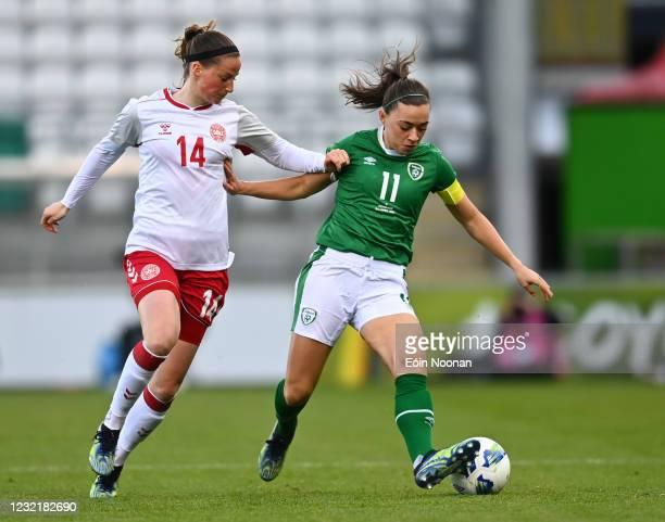 Dublin , Ireland - 8 April 2021; Katie McCabe of Republic of Ireland in action against Nicoline Sorensen of Denmark during the women's international...