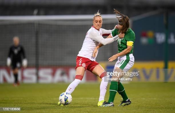 Dublin , Ireland - 8 April 2021; Sanne Troelsgaard of Denmark in action against Katie McCabe of Republic of Ireland during the women's international...