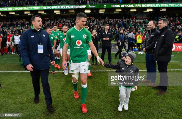 Dublin Ireland 8 February 2020 Ireland captain Jonathan Sexton accompanied by his son Luca and IRFU Communications manager David O Siochain after the...
