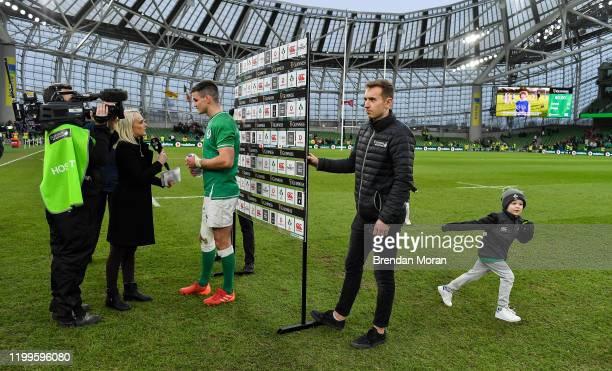 Dublin Ireland 8 February 2020 Ireland captain Jonathan Sexton is interviewed by Sinead Kissane of Virgin Media television as his son Luca runs on...