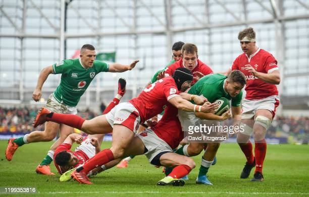 Dublin Ireland 8 February 2020 Jordan Larmour of Ireland on his way to scoring his side's first try depsite the tackle of Leigh Halfpenny of Wales...