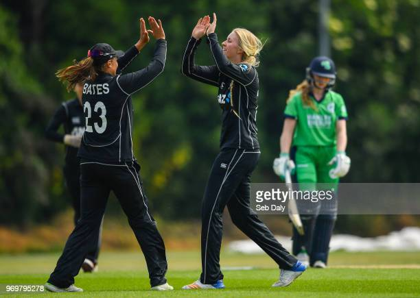 Dublin Ireland 8 June 2018 Hannah Rowe of New Zealand right is congratulated by teammate Suzie Bates after bowling out Una RaymondHoey of Ireland...