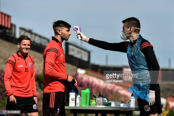 Dublin , Ireland - 8 June 2020; Danny Mandroiu has his temperature taken by Aaron Fitzsimons, Equipment Manager, ahead of a Bohemian FC training...