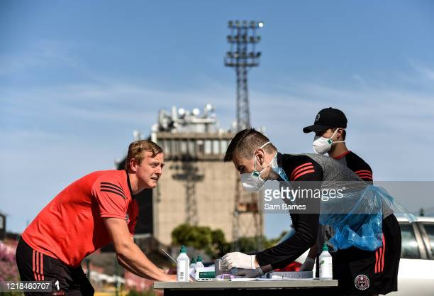 Dublin , Ireland - 8 June 2020; James Talbot, left, signs in infront of Aaron Fitzsimons, Equipment Manager, centre, and Cathal Murtagh, Sports...