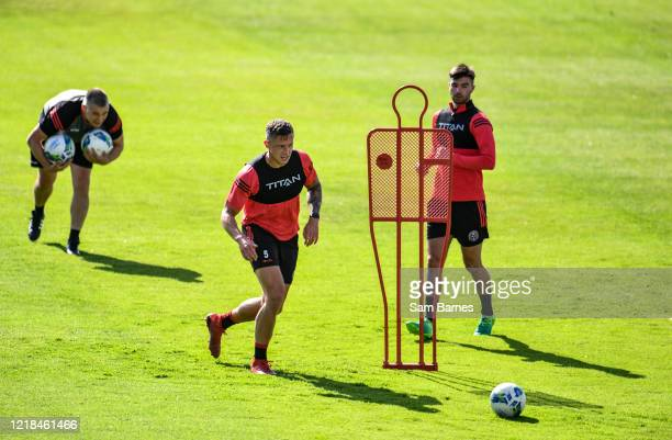Dublin , Ireland - 8 June 2020; Rob Cornwall, centre, and Danny Mandroiu during a Bohemian FC training session at Dalymount Park in Dublin. Following...