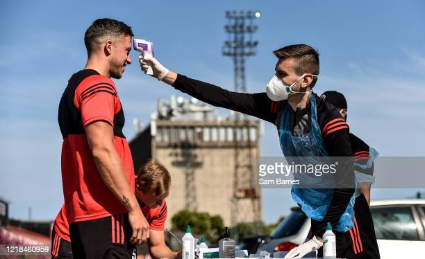 Dublin , Ireland - 8 June 2020; Rob Cornwall has his temperature taken by Aaron Fitzsimons, Equipment Manager, ahead of a Bohemian FC training...