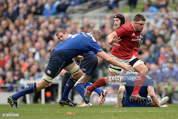 Dublin Ireland 8 October 2016 CJ Stander of Munster is tackled by Devin Toner of Leinster during the Guinness PRO12 Round 6 match between Leinster...