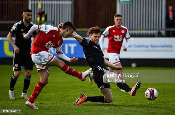 Dublin , Ireland - 9 April 2021; Darragh Burns of St Patrick's Athletic shoots to score his side's second goal despite the attention of Cameron...