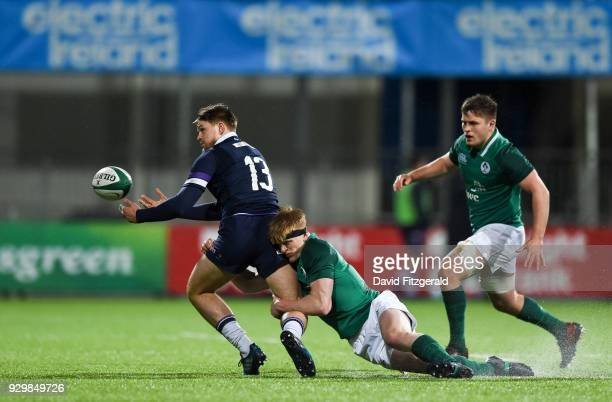 Dublin Ireland 9 March 2018 Fraser Strachan of Scotland is tackled by Tommy O'Brien of Ireland during the U20 Six Nations Rugby Championship match...