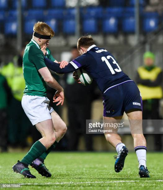 Dublin Ireland 9 March 2018 Fraser Strachan of Scotland performs a hand off on Tommy O'Brien of Ireland during the U20 Six Nations Rugby Championship...