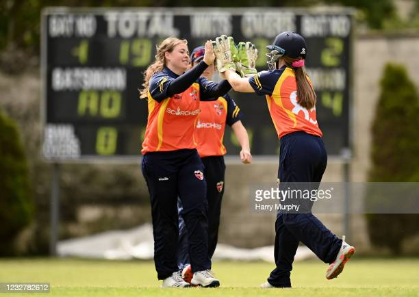 Dublin , Ireland - 9 May 2021; Cara Murray, left, and Shauna Kavanagh of Scorchers celebrate bowling out Georgina Dempsey of Typhoons during the...