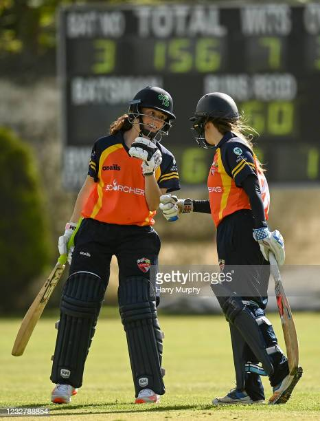 Dublin , Ireland - 9 May 2021; Lara Maritz of Scorchers fistbumbs batting partner Anna Kerrison after hitting a boundary during the third match of...