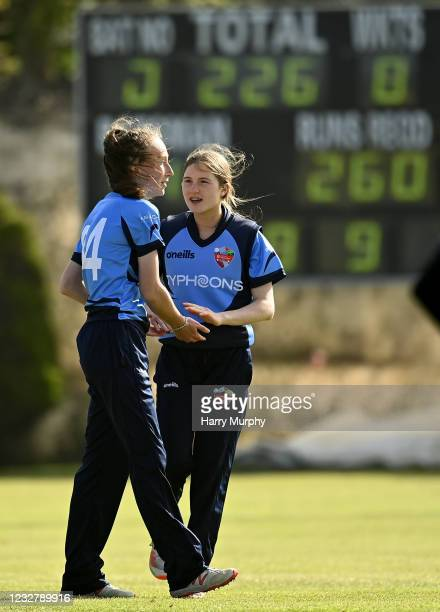 Dublin , Ireland - 9 May 2021; Orla Prendergast of Typhoons celebrates with team-mate Georgina Dempsey after bowling out Lara Maritz of Scorchers...