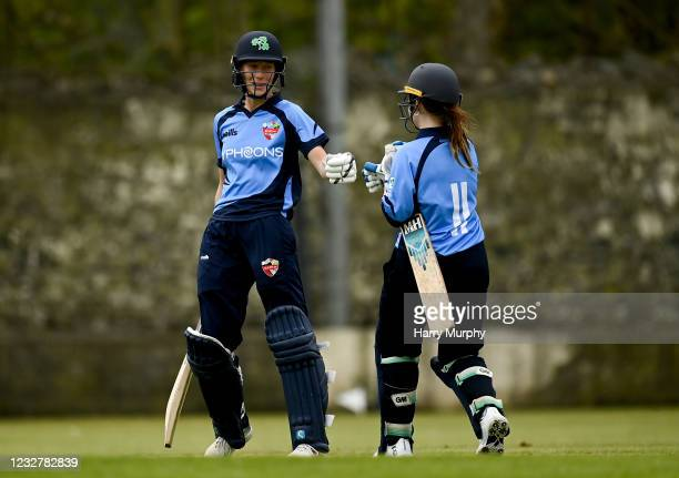 Dublin , Ireland - 9 May 2021; Orla Prendergast of Typhoons fist bumps her batting partner Maria Kerrison as she reaches 100 during the third match...